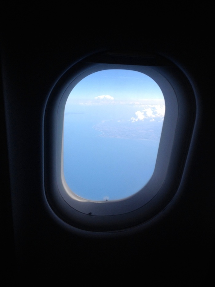 You can just make out the French coastline through the plane window.