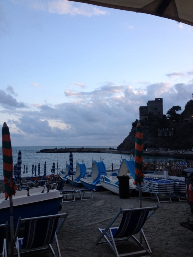 The view of the sunset over Monterosso's pier and castle from our dinner table