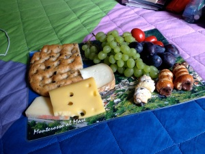 Post-swim picnic, set out on one of the scenic photograph placemats we bought in Corniglia.