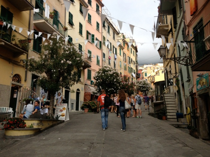 The wide, steep main street of Riomaggiore climbed high up the edge of the mountain. Riomaggiore seemed large by comparison with the three middle villages, perhaps just a little smaller than Monterosso.