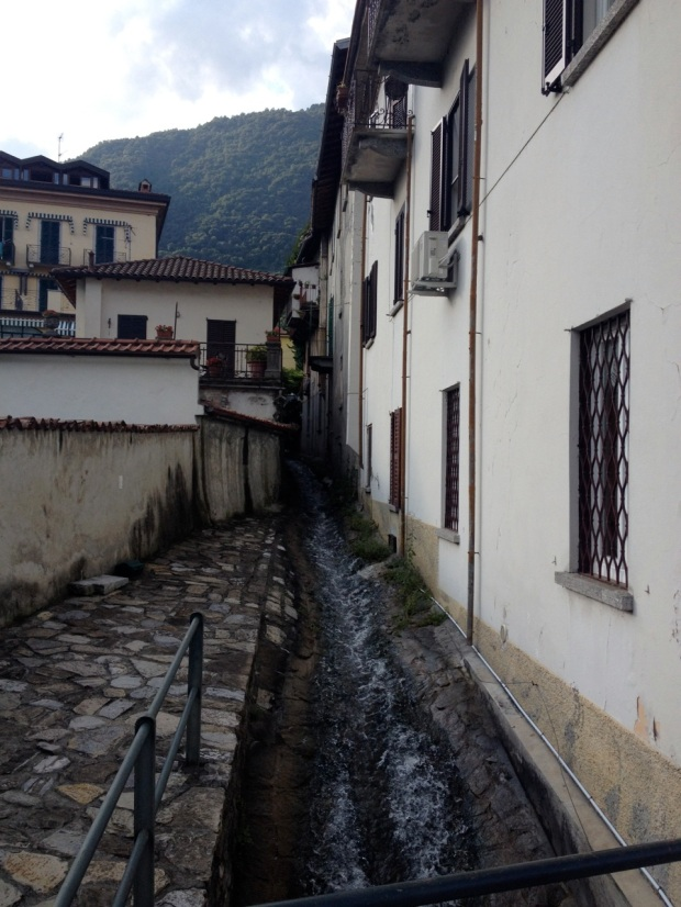 This is water running down from the snow melting up in the Alps. It roared through this gutter in between these buildings and spilled into the lake.
